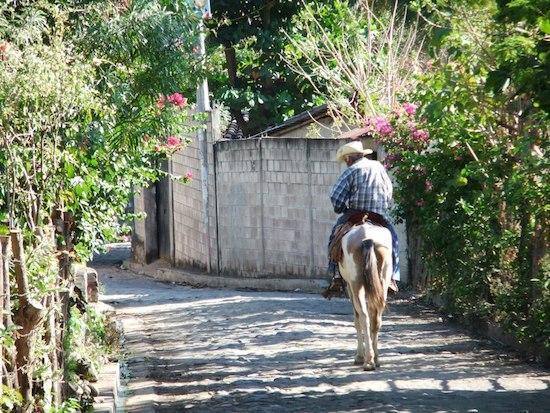 Riding a donkey in El Salvador